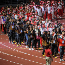 The Malaysian contingent parading at the New Clark City Athletics Stadium as the 30th SEA Games in the Philippines drew to a close on Dec 11. — Bernama