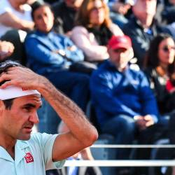 In this file photo taken on May 16, 2019 Switzerland's Roger Federer reacts as he lose a point against Croatia's Borna Coric during their ATP Masters tournament tennis match at the Foro Italico in Rome. - AFP