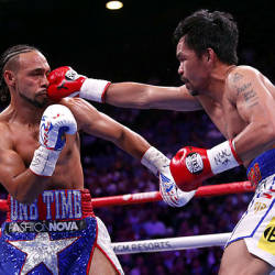 Manny Pacquiao (right) lands a punch on Keith Thurman during their WBA welterweight title fight at the MGM Grand Garden Arena on July 20, 2019 in Las Vegas, Nevada. — AFP