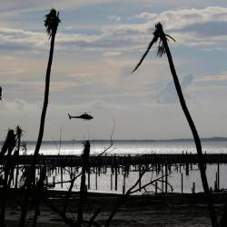 An unidentified helicopter lands to deliver food and water in the aftermath of Hurricane Dorian on the Great Abaco island town of Marsh Harbour, Bahamas, Sept 4, 2019. - Reuters