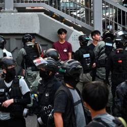 Police detain people outside a wet market during a protest in Tuen Mun district of Hong Kong on November 10, 2019. - AFP