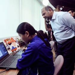 Communications and Multimedia Minister Gobind Singh Deo looks at the work of students of the Kre8tif @School programme. - Bernama
