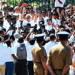 Sri Lanka's new president Gotabhaya Rajapakse (C) gestures to his supporters upon his arrival at the Temple of the Sacred Tooth Relic in Kandy on November 20, 2019. - AFP