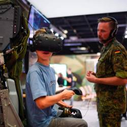 A boy visits the German Armed Forces Bundeswehr stand during the Video games trade fair Gamescom in Cologne, Germany, on Aug 21, 2019. - AFP