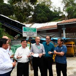 Penang Chief Minister Chow Kon Yeow (3rd from L) reviews the maintenance work being done by the Penang Hill Corporation today. - Bernama