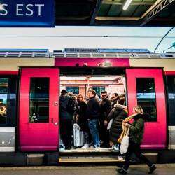 Commuters enter in a train at Gare de L'Est trains station in Paris, on Dec 13, 2019, during a strike of Paris' public transports operator RATP and of the French state railway company SNCF employees over French government's plan to overhaul the country's retirement system. — AFP