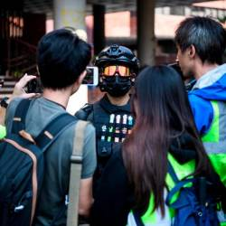 A male protester (C), who gave his age as 16, speaks to the media at the campus of the Hong Kong Polytechnic University in the Hung Hom district of Hong Kong on Nov 20. — AFP