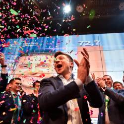 Ukrainian comedian and presidential candidate Volodymyr Zelensky reacts after the announcement of the first exit poll results in the second round of Ukraine's presidential election at his campaign headquarters in Kiev on April 21, 2019. — AFP