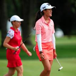 Teammates Karine Icher (L) and Celine Boutier of France walk off the 17th green during round two of the Dow Great Lakes Bay Invitational at Midland Country Club on July 18, 2019 in Midland, Michigan. — AFP