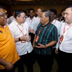 DAP secretary-general Lim Guan Eng (2nd L), Negri Sembilan Mentri Besar Datuk Seri Aminuddin Harun (2nd R), and Transport Minister Anthony Loke Siew Fook, during the state DAP's annual convention, in Seremban, on Sept 22, 2019. — Bernama