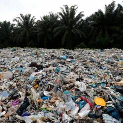 Plastic waste is piled outside an illegal recycling factory in Jenjarom, Kuala Langat, October 14, 2018. - Reuters