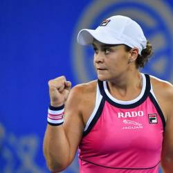 Ashleigh Barty of Australia celebrates after winning against Caroline Garcia of France during their second round women's singles match at the Wuhan Open tennis tournament in Wuhan on Sept 24. — AFP