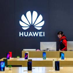 A staff member is seen inside a Huawei retail store in Shanghai, China May 8, 2019. - Reuters