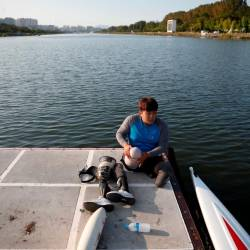 Former South Korean Army sergeant, first class, Ha Jae-hun, who lost both his legs in 2015 when he stepped on a North Korean landmine while on a patrol in the demilitarized zone (DMZ), puts on his artificial legs after a practice session at Misari Rowing Stadium in Hanam, South Korea Sept 24, 2019. — Reuters