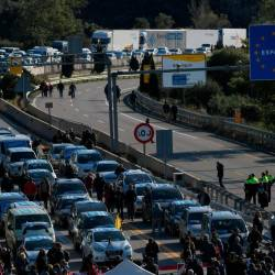 Protesters block the AP-7 highway at the Spanish-French border in La Jonquera, northern Spain, on Nov 11 during an action called by Tsunami Democratic movement for civil disobedience actions. — AFP