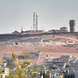 "This picture taken on Oct 12, 2019 from Turkey near the town of Suruc shows a US observation post near the Syrian town of Kobani Kobane where the Pentagon said an explosion occurred ""within a few hundred meters"". — AFP"