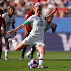 United States' forward Megan Rapinoe scores a goal during the France 2019 Women's World Cup round of sixteen football match between Spain and USA, on June 24, 2019, at the Auguste-Delaune stadium in Reims, France. - AFP