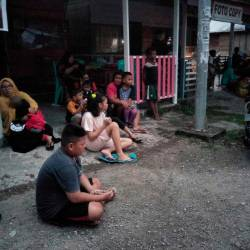 Indonesian people stay out of their homes following 7.3 magnitude earthquake in Labuha, North Maluku on July 14, 2019. — AFP