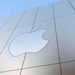 In this file photo taken on Sept 22, 2017 an Apple logo is seen on the outside of an Apple store in San Francisco, California. - AFP