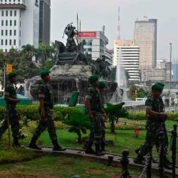 Indonesian soldiers patrol near the constitutional court in Jakarta on June 14, 2019, as the court hears a defeated presidential challenger's claim that Indonesia's 2019 election was rigged, allegations that spawned deadly rioting last month. - AFP