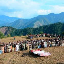 People gather during funeral prayer for victims of cross border shelling in Nosari sector in Pakistan-administered Kashmir on Oct 20, 2019. — AFP