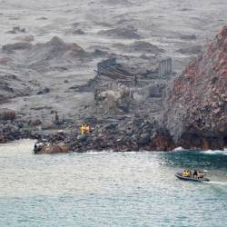 This handout photo taken and released on December 13, 2019 by the New Zealand Defence Force shows elite soldiers taking part in a mission to retrieve bodies from White Island after the December 9 volcanic eruption, off the coast from Whakatane on the North Island. - AFP