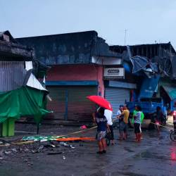 Residents look at a destroyed building after a 6.8- magnitude earthquake in the town of Padada in Davao del Sur province on the southern island of Mindanao. - AFP
