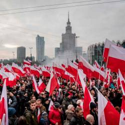 People wave national flags during a march to mark Poland's National Independence Day on Nov 11 in Warsaw. — AFP