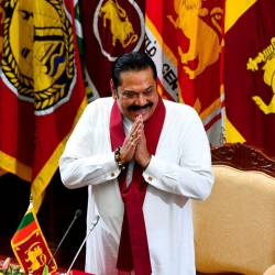 Sri Lanka's new Prime Minister Mahinda Rajapaksa gestures upon his arrival for a ministerial swearing-in ceremony in Colombo on Nov 22, 2019. — AFP