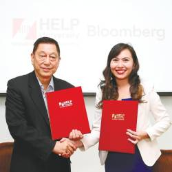 Chan with Bloomberg Malaysia head of sales, Wendnia Tan, at the opening of the 'Lab'.