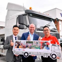 From left: Seri Zenith Engineering representative PJ Koh, Peden and KSK representative Justin Cheah in front of the Volvo FM heavy-duty lorry to be donated to KSK.