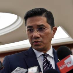Economic Affairs Minister Datuk Seri Azmin Ali answers questions in the Parliament lobby today. - Bernama