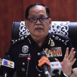 Bukit Aman Investigation and Traffic Enforcement Department director Datuk Azisman Alias. - Bernama