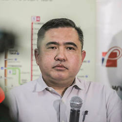 Filepix taken on Aug 20 shows Transport Minister Anthony Loke during the launch of the Four-Car Monorail Flag Off at KL Sentral Monorail Station, Kuala Lumpur. — Sunpix by Adib Rawi Yahya