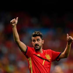 In this file photo taken on September 2, 2017 Spain's forward David Villa waves as he celebrates their victory at the end of the World Cup 2018 qualifier football match Spain vs Italy at the Santiago Bernabeu stadium in Madrid. - AFP