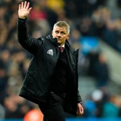 In this file photo taken on October 06, 2019 Manchester United's Norwegian manager Ole Gunnar Solskjaer gestures to supporters on the pitch after the English Premier League football match between Newcastle United and Manchester United at St James's Park in Newcastle-upon-Tyne, north east England on October 6, 2019. - AFP