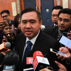 Transport Minister Anthony Loke Siew Fook answers questions from the media in the Parliament lobby today. - Bernama
