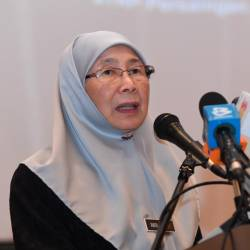 Deputy Prime Minister Datuk Seri Dr Wan Azizah Wan Ismail speaks during the Fair Competition and Cost of Living Symposium in Putrajaya today. - Bernama