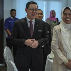 Finance Minister Lim Guan Eng and Housing and Local Government Minister Zuraida Kamaruddin attend the Meeting with PKP at the Temporary Parliament Building yesterday. - Bernama