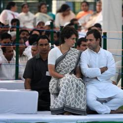 This handout photograph released by the AICC (All India Congress Committee) Communication Department on May 21, 2019, shows Congress president Rahul Gandhi (R) speaking with his sister Priyanka Gandhi Vadra, the Congress general secretary for eastern Uttar Pradesh. - AFP