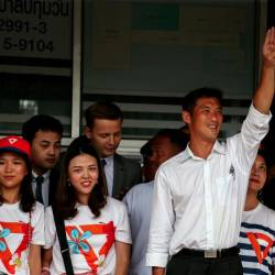 Thanathorn Juangroongruangkit, leader of the Future Forward Party flashes a three-finger salute to his supporters as he leaves a police station after hearing a sedition complaint filed by the army, in Bangkok, Thailand on April 6, 2019. — Reuters