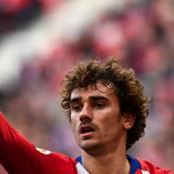 In this file photo taken on Feb 9, 2019 Atletico Madrid's French forward Antoine Griezmann celebrates after scoring during the Spanish league football match Club Atletico de Madrid against Real Madrid CF at the Wanda Metropolitano stadium in Madrid. - AFP