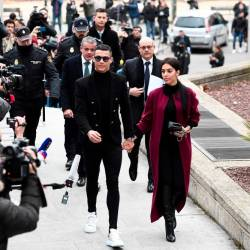 Juventus' forward and former Real Madrid player Cristiano Ronaldo arrives with his Spanish girlfriend Georgina Rodriguez to attend a court hearing for tax evasion in Madrid on Jan 22, 2019. — AFP