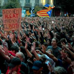 Protesterd hold a sign reading in Catalan We have already risen up and we will cause the execitioner's falldown during a protest called by Picnic for the Republic pro-independence movement outside the Spanish Government's regional office in Barcelona on Oct 20, 2019. — AFP