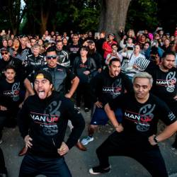 Members of different biker gangs perform the haka as a tribute to victims in Christchurch on March 20, 2019, five days after the twin mosque shootings. — AFP