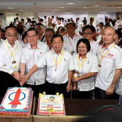 DAP Secretary-General Lim Guan Eng and other senior party officials cut a cake in conjunction with the opening of the 2019 Kuala Lumpur Federal Territories DAP convention today. - Bernama