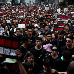 Thousands of protesters dressed in black take part in a new rally against a controversial extradition law proposal in Hong Kong on June 16, 2019. — AFP