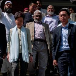 Hong Kong's Chief Executive Carrie Lam (C) exits the Kowloon Mosque, or Kowloon Masjid and Islamic Centre, in the Tsim Sha Tsui district in Hong Kong on Oct 21, 2019. — AFP