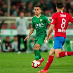 This photo taken on April 14, 2019 shows Nico Yennaris (L), also known as Li Ke, of Beijing Guoan controling the ball against Henan Jianye during their Chinese Super League match in Beijing. — AFP