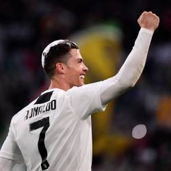 Juventus' Portuguese forward Cristiano Ronaldo acknowledges fans and celebrates after Juventus secured its 8th consecutive Italian 2018/19 Scudetto Serie A championships, after winning the Italian Serie A football match Juventus vs Fiorentina on April 20, 2019 at the Juventus stadium in Turin. — AFP